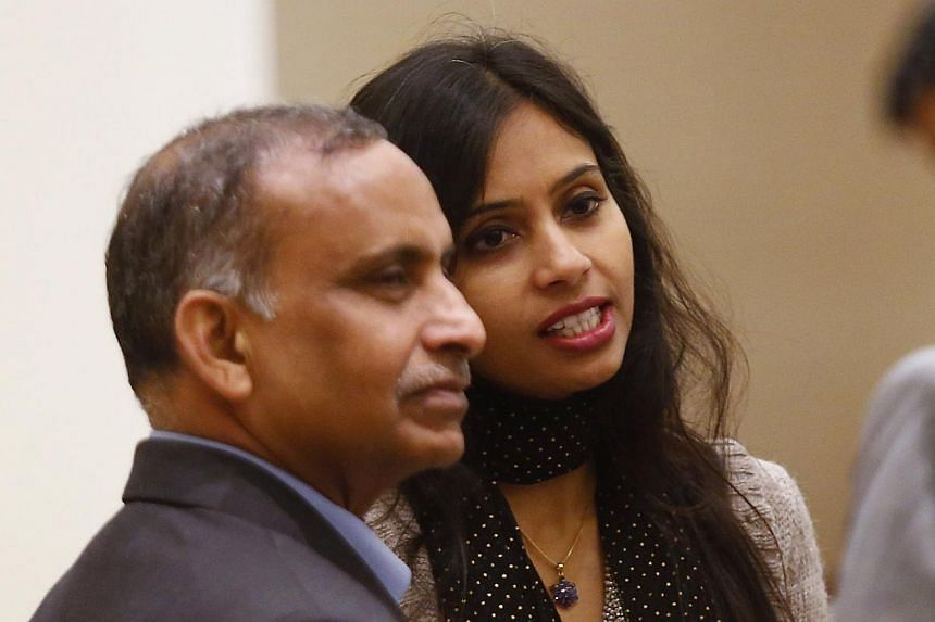 Indian diplomat Devyani Khobragade (right) and her father Uttam Khobragade talk to unidentified guests at the Maharashtra Sadan state guesthouse after their meeting with India's Foreign Minister Salman Khurshid in New Delhi, on Jan 11, 2014. India on