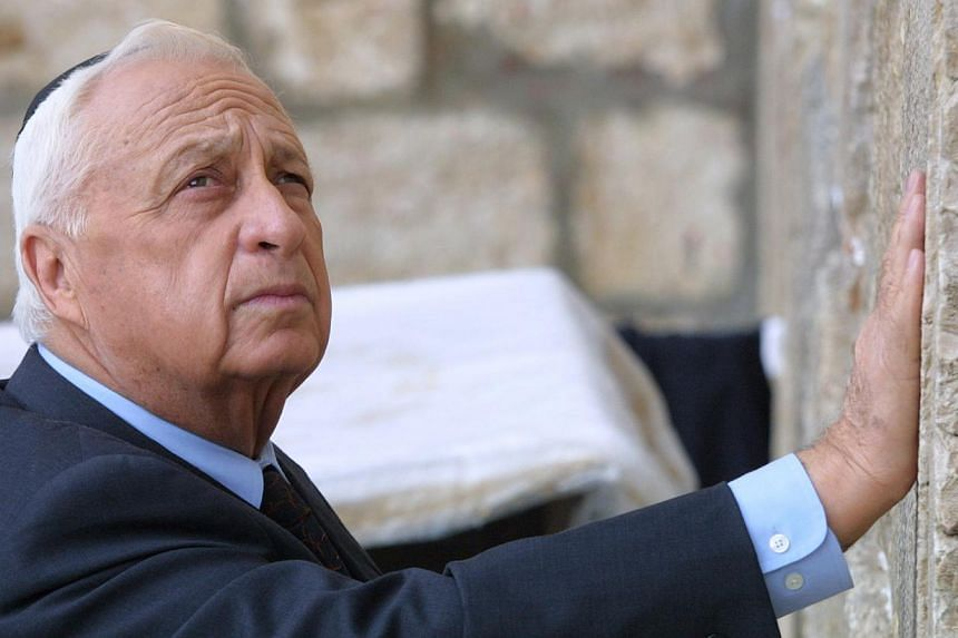 Mr Ariel Sharon places his hand on the Western Wall, Judaism's holiest site, in the Old City of Jerusalem, on Feb 7, 2001. A maverick in war and politics, Israel's Ariel Sharon reshaped the Middle East in a career marked by adventurism and disgrace,