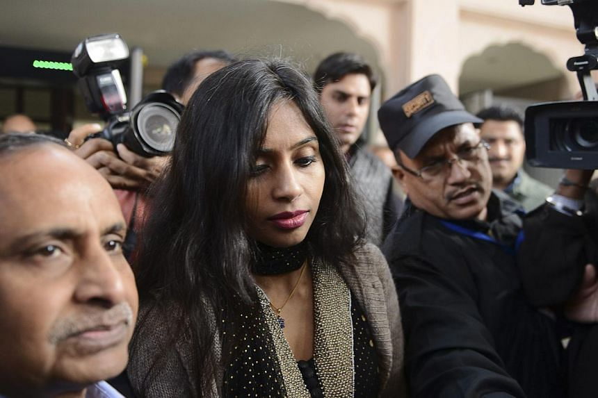 Indian diplomat Devyani Khobragade (centre) leaves with her father Uttam Khobragade (left) from the Maharashtra Sadan state guesthouse to meet India's Foreign Minister Salman Khurshid in New Delhi, on Jan 11, 2014. A US diplomat in New Delhi was head