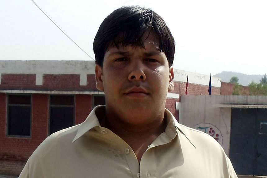 This undated family handout photograph released on Jan 10, 2014, shows Pakistani student Aitzaz Hassan, who was killed in a suicide attack outside his school in Hangu district. -- PHOTO: AFP/FAMILY HANDOUT