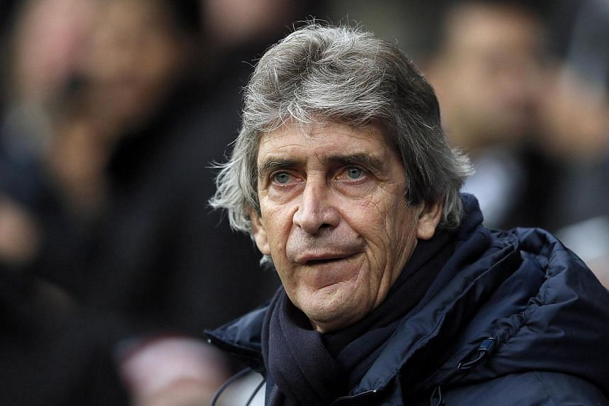 Manchester City manager Manuel Pellegrini watches the start of their FA Cup third round match against Blackburn Rovers at Ewood Park in Blackburn, north-west England, on Jan 4, 2014. Pellegrini believes his side must improve if they are to reclaim th