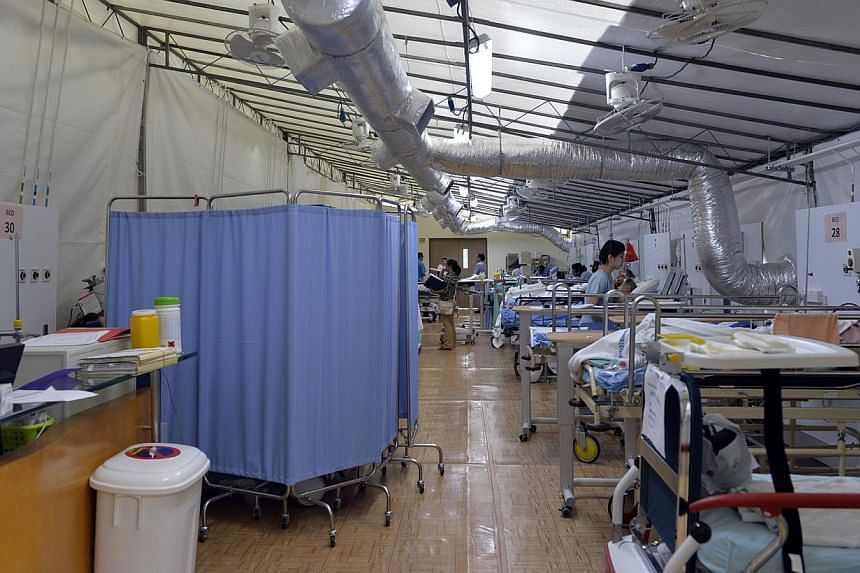 Patients waiting for beds in a large air-conditioned tent at Changi General Hospital (CGH) on Jan 7, 2014. The solution to the ongoing hospital bed crunch cannot just lie in adding new beds, says Mr Foo Hee Jug, the head of the upcoming Ng