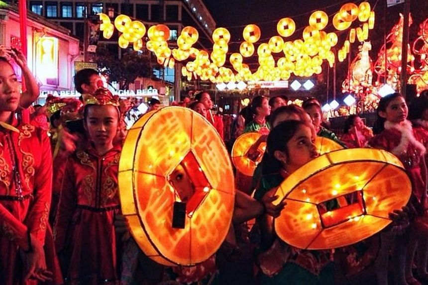 Chinatown came to life on Saturday, with the streets awashed in shades of gold and flanked by 176 horse-shaped lanterns to usher in the Chinese Year of the Horse. -- ST PHOTO: KEVIN LIM