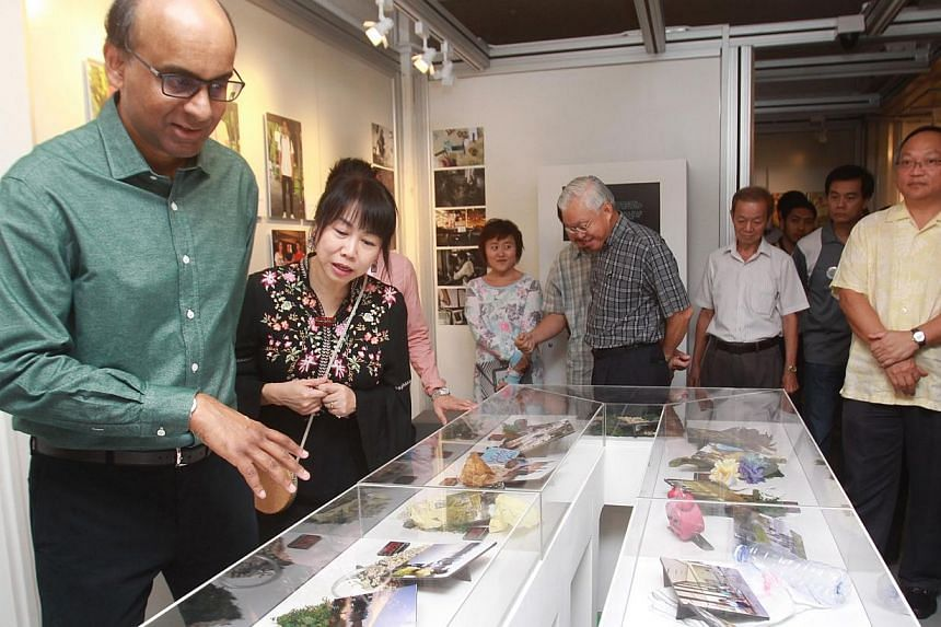 Our Museum @ Taman Jurong celebrated its first anniversary on Sunday with an open house for hundreds of residents. Deputy Prime Minister Tharman Shanmugaratnam (left), advisor to Taman Jurong Grassroots Organisations, was the guest of honour at the e