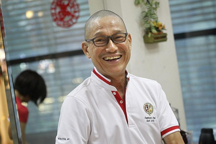 Mr Gwee Peng Hong smiles after getting his head shaved at Little Red Dot to raise funds for The Straits Times' School Pocket Money Fund on Jan 12, 2014. -- ST PHOTO: KEVIN LIM