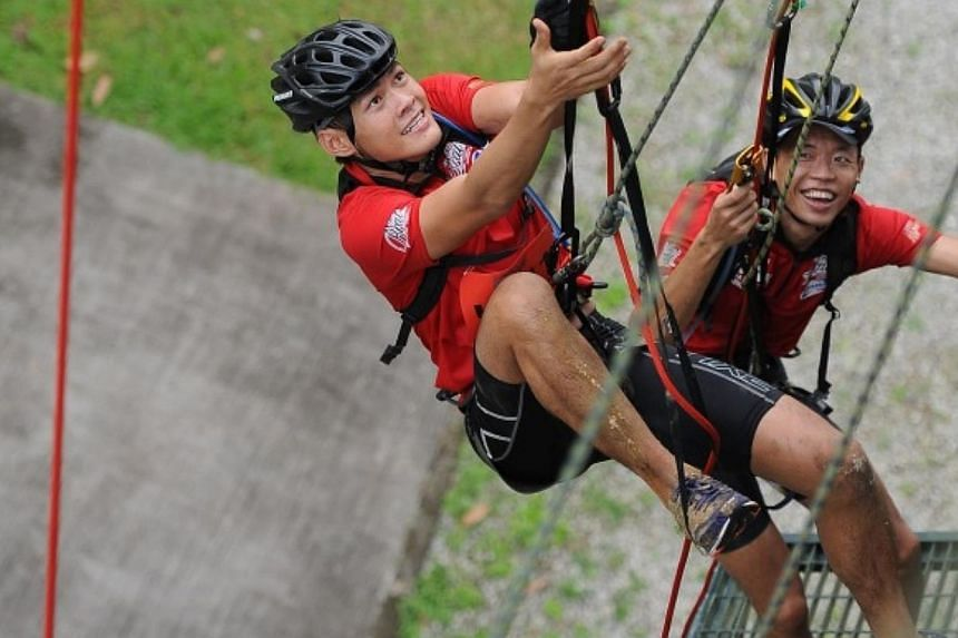 Ultra category participants jumaring up a tower.-- PHOTO:SAFRA