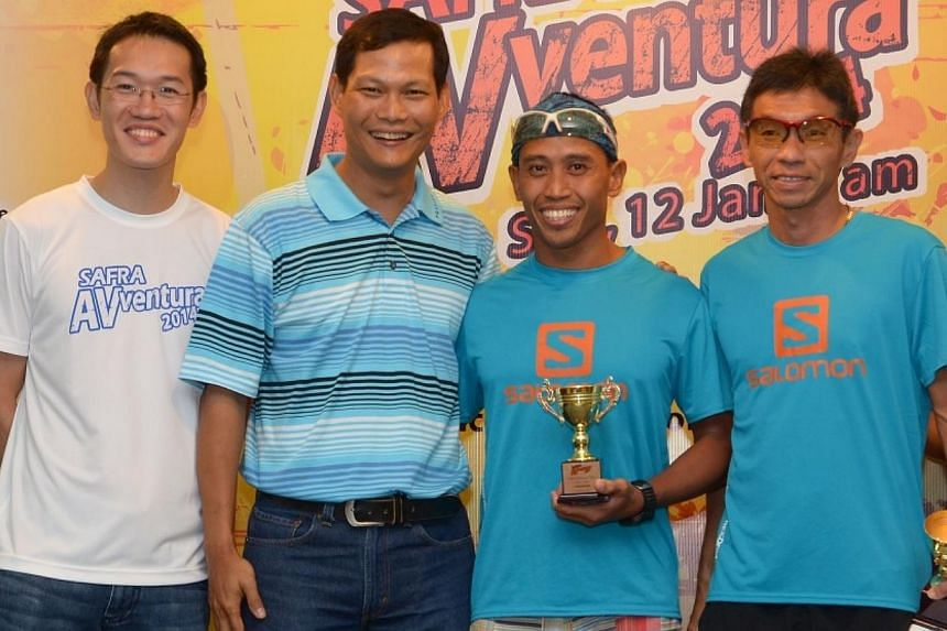 Winners of the Ultra Men's category Yeo Kim Hong and Hairul Nazwa receiving the award from BG (NS) Tung Yui Fai, vice-president of Safra (second from left).-- PHOTO:SAFRA