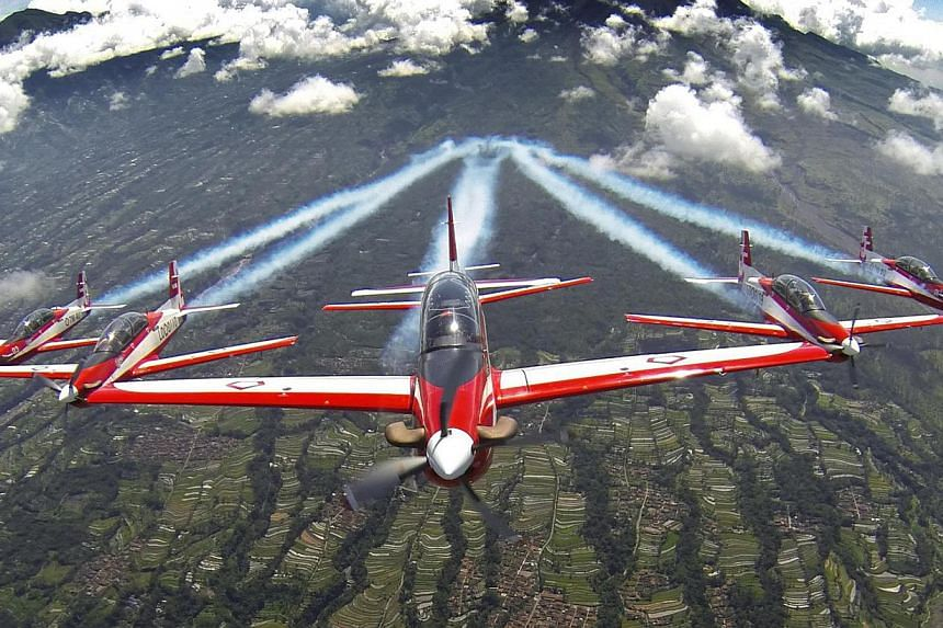 The aerial display teams that will perform at the Singapore Airshow include the Indonesian Air Force's Jupiter Aerobatic Team (above), the South Korean Air Force's Black Eagles and the RSAF's Black Knights. -- PHOTOS: FACEBOOK PAGE OF JUPITER AEROBAT