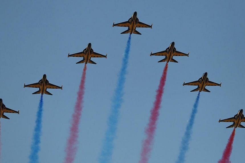 The aerial display teams that will perform at the Singapore Airshow include the Indonesian Air Force's Jupiter Aerobatic Team, the South Korean Air Force's Black Eagles (above) and the RSAF's Black Knights. -- PHOTO: BLOOMBERG