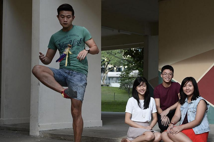 Mr Gordon Toh showing off his chapteh skills at a Potong Pasir void deck. He and his teammates (seated, from left) Carolanne Chan, Keith Kay and Gina Foo plan to hold storytelling sessions and workshops for children and their parents.