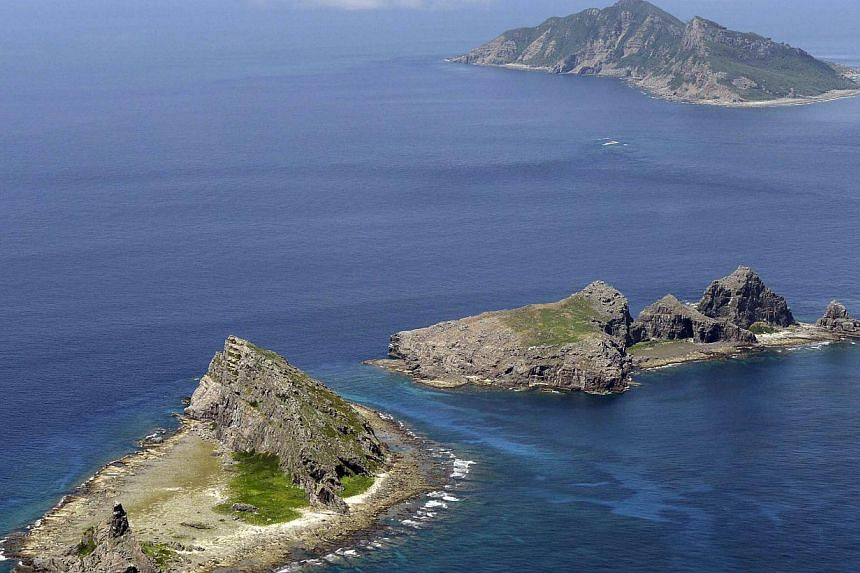 A group of disputed islands, Uotsuri island (top), Minamikojima (bottom) and Kitakojima, known as Senkaku in Japan and Diaoyu in China is seen in the East China Sea, in this photo taken by Kyodo September 2012. Three Chinese ships entered disputed wa