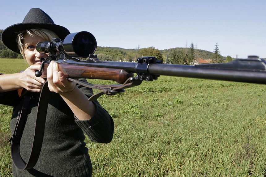 Austrian huntress Evelin Grubelnig is pictured with her Mauser bolt action rifle during a morning stalk at the Szeuizvoelgyi hunting grounds on Oct 12, 2013, near Kisbucsa, Hungary. -- FILE PHOTO: AFP