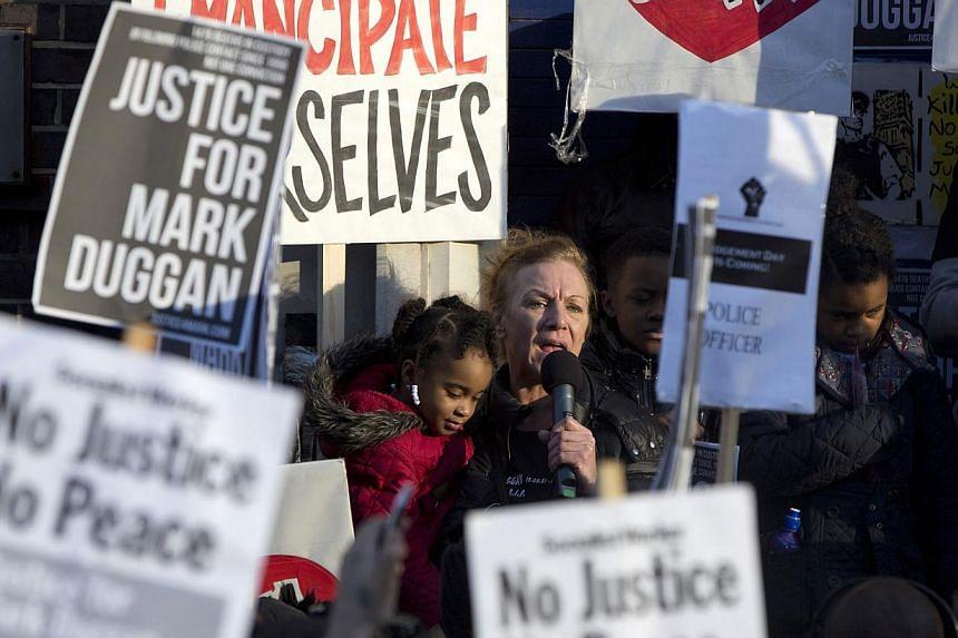 Ms Carole Duggan speaks during a vigil for her nephew Mark Duggan, outside Tottenham Police Station in Tottenham, north London on Jan 11, 2014. -- PHOTO: REUTERS