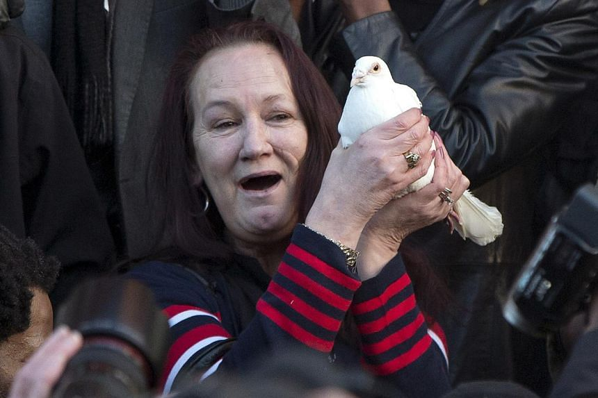 Ms Pamela Duggan holds a symbolic dove during a vigil for her son Mark Duggan, outside Tottenham Police Station in Tottenham, north London on Jan 11, 2014. -- PHOTO: REUTERS