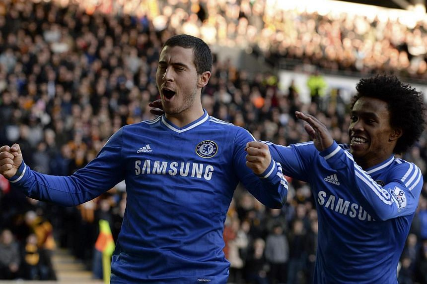 Chelsea's Eden Hazard (left) celebrates scoring his goal against Hull City with teammate Willian during their English Premier League soccer match at The KC Stadium in Hull, northern England on Jan 11, 2014. -- PHOTO: REUTERS