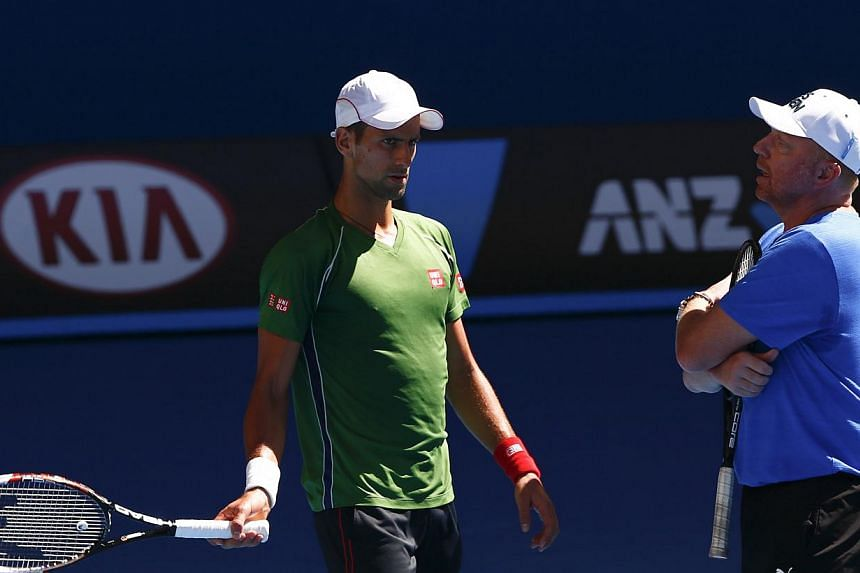 Novak Djokovic of Serbia talks with his coach Boris Becker of Germany during a practice session before the Australian Open 2014 tennis tournament in Melbourne, Jan 12, 2014.Djokovic said he was happy to take a risk on his untried new coach as h