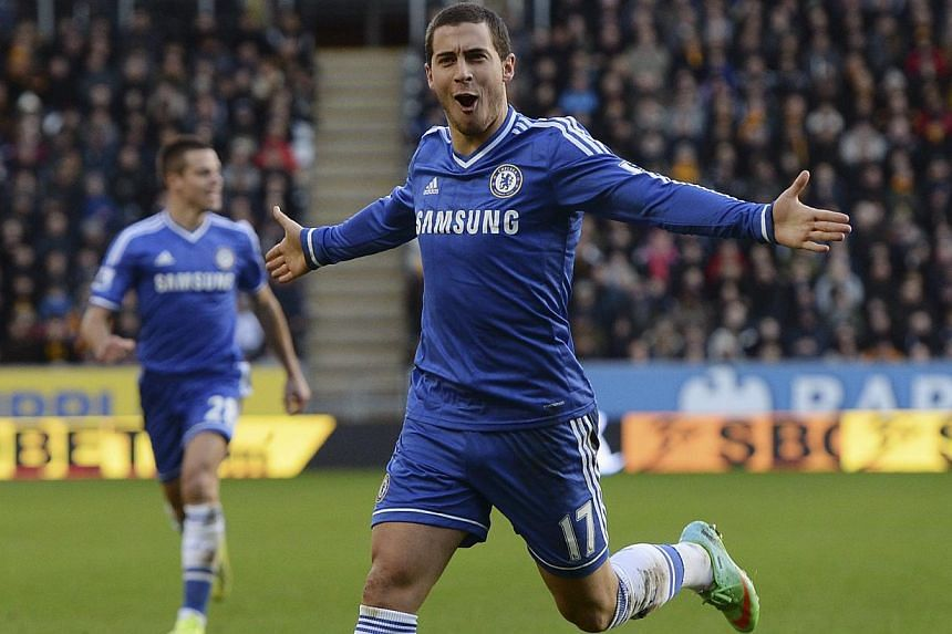 Chelsea's Eden Hazard celebrates scoring his goal against Hull City during their English Premier League soccer match at The KC Stadium in Hull, northern England on Jan 11, 2014. Hazard and Fernando Torres applied the gloss to a workmanlike 2-0 victor