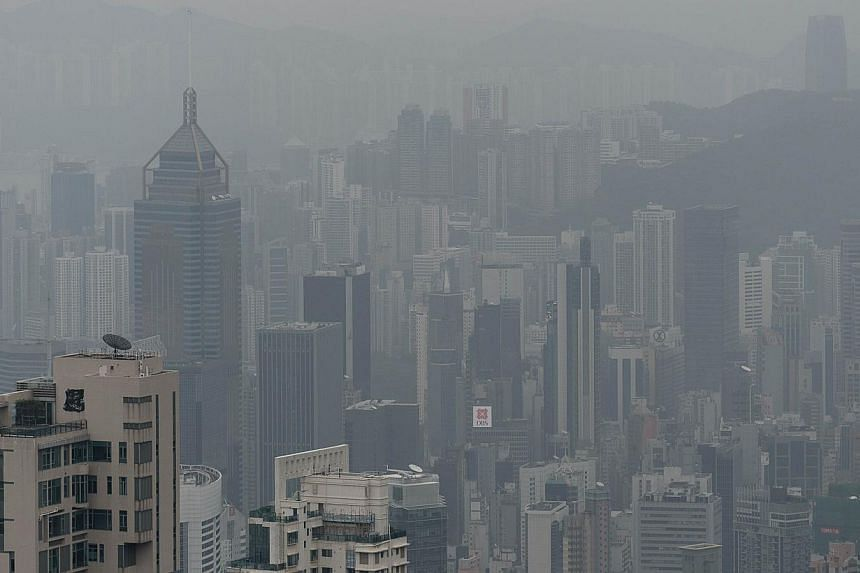 This picture taken on Jan 9, 2014, shows a haze of toxic pollution over Hong Kong. The New Year has revived old problems for Hong Kong as a murky smog blankets the usually glittering skyline, fuelling complaints from locals and visitors alike, and ra