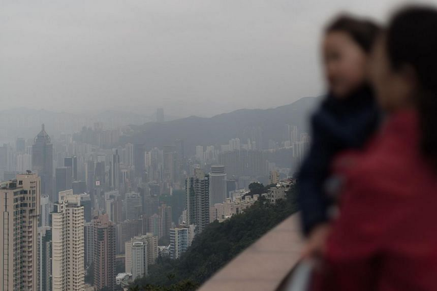 This picture taken on Jan 9, 2014, shows a haze of toxic pollution over Hong Kong. -- PHOTO: AFP