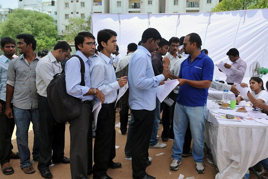 Job-seekers wait in line to register at a career fair held at a school in Hyderabad on May 19, 2012.Desperate candidates are forging qualifications, faking experience, inventing companies and resorting to all sorts of fraud to land jobs in a to