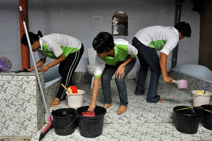 Singapore bound trainee maids learning basic household chores in the PT Devipengayom Bangsa training centre in Pati, Indonesia. The Indonesian Embassy in Singapore is calling for psychological testing of maids before they arrive here, in a bid to rai