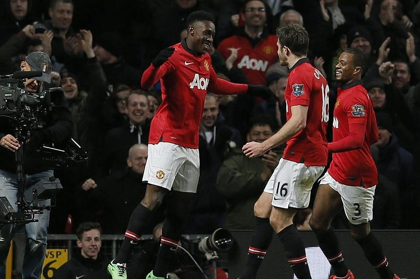 Manchester United's Danny Welbeck (left) celebrates his goal against Swansea City with team mates during their English Premier League soccer match at Old Trafford in Manchester, northern England on Jan 11, 2014. -- PHOTO: REUTERS