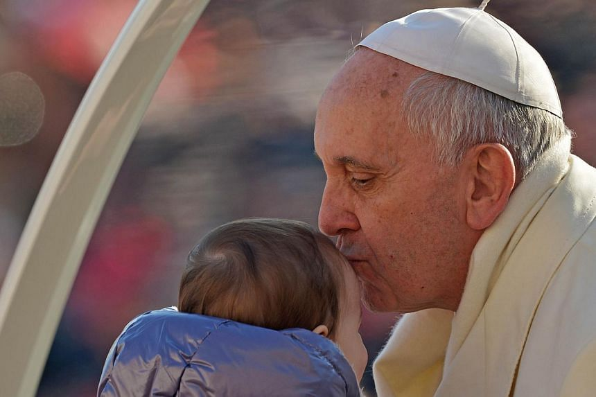 Pope Francis baptised 32 babies in the Sistine Chapel on Sunday and told their mothers to have no qualms about feeding them there. -- FILE PHOTO: AFP