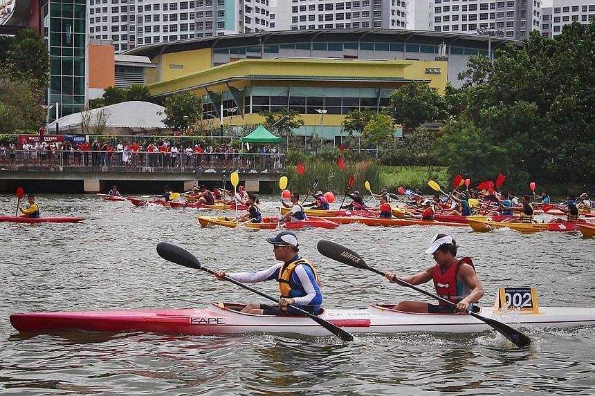 In addition to four competitive race categories, the 12th edition of the Singapore Canoe Marathonalso featured a fun race which saw Mr Desmond Lee, Minister of State for National Development, Acting Manpower Minister Tan Chuan-Jin (in white-and