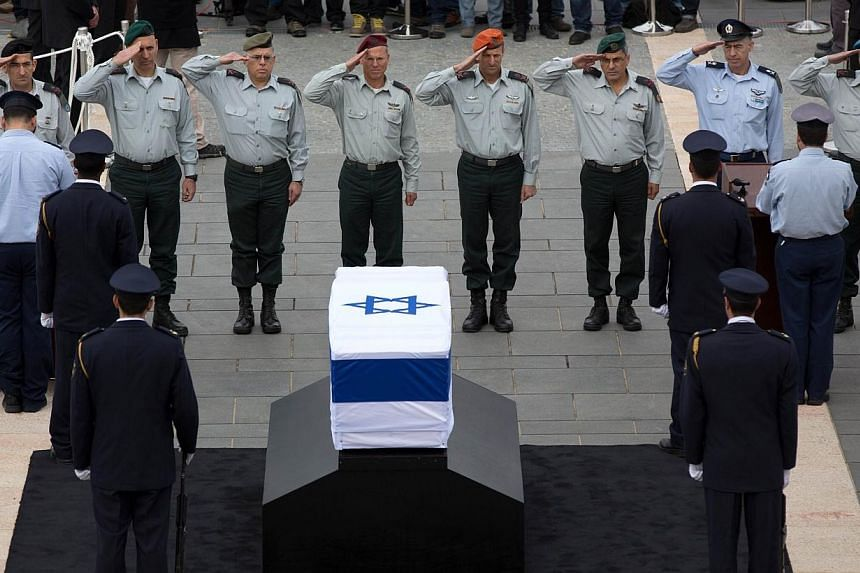 Israeli Generals salute in front of the coffin of former prime minister Ariel Sharon at theKnesset, Israel's parliament, in Jerusalem, on Sunday, Jan 12, 2014. -- PHOTO: AFP