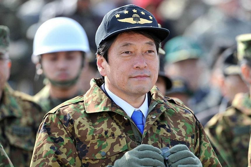 Japanese Defence Minister Itsunori Onodera holds a pair of binoculars as he inspects the new year exercise of Japanese Ground Self Defense Forces' airbourne troops in Narashino in Chiba prefecture, suburban Tokyo on Sunday, Jan 12, 2014. Mr Onod