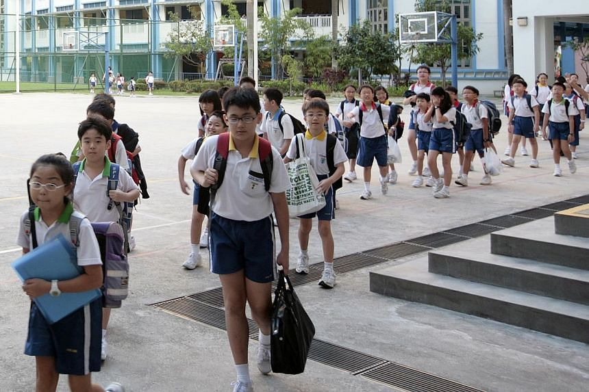 "Singapore pays a lot of attention to education as the path for children to have ""every chance to succeed"" regardless of their family background, income level or which school they attend, said Prime Minister Lee Hsien Loong on Sunday. -- ST FILE PHOTO"