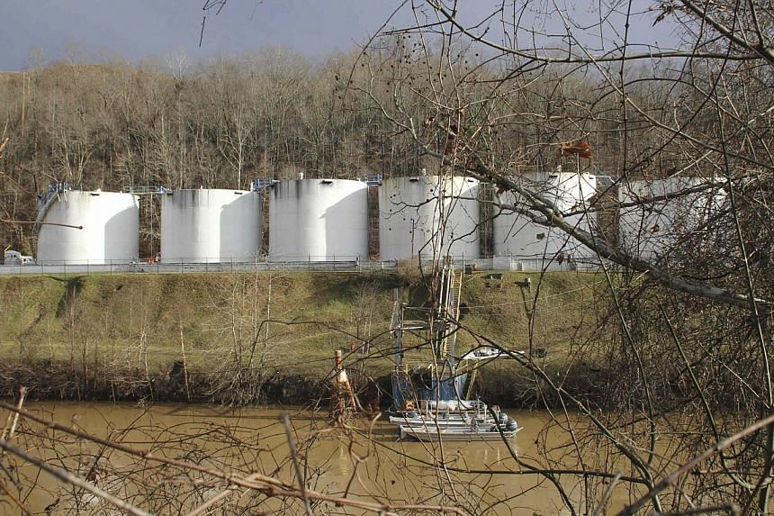 Boats sit in the Elk River in front of the Freedom Industries plant in Charleston, West Virginia on Jan 11, 2014. Tap water in Charleston, West Virginia, and nearby communities will remain unsafe in the coming days, an official said on Saturday as re