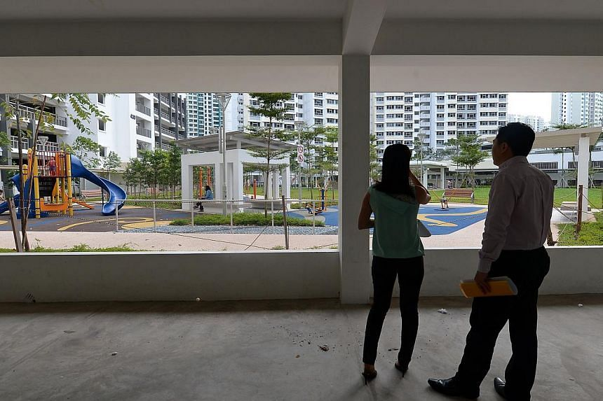 Ms Chua Sin Oon and Mr Alex Ong from the Early Childhood Development Agency checking if a void deck is suitable for a childcare centre. For instance, there must be a playground within walking distance, and children should not have to cross any roads