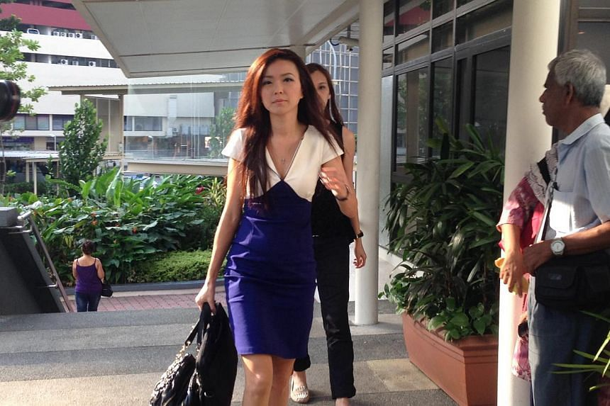 Serina Wee was the first to arrive at court this morning -- ST PHOTO:MELODY ZACCHEUS