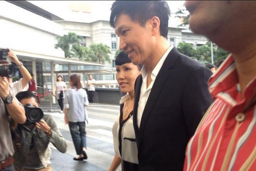 Kong Hee and his wife Sun Ho were the last of the six accused to arrive at court this morning.-- ST PHOTO: MELODY ZACCHEUS