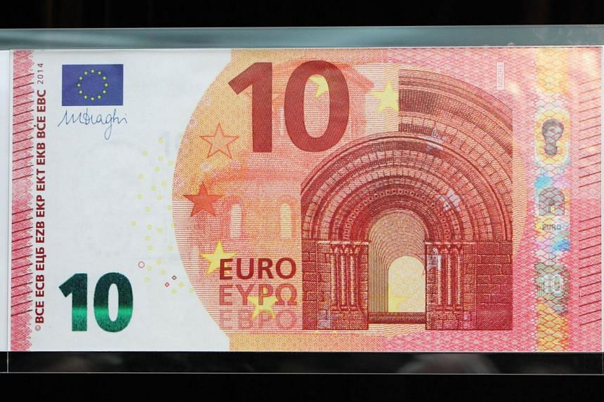A giant copy of the new 10-euro banknote is displayed at the ECB headquarters in Frankfurt, on Jan 13, 2014. The European Central Bank revealed on Monday the new 10-euro banknotes including a portrait of the Greek mythological figure of Europa that w