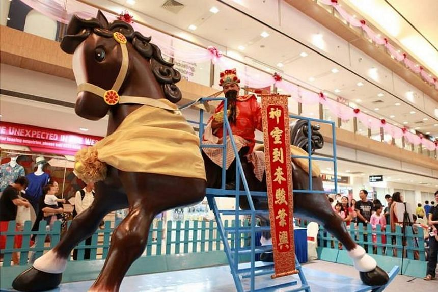 From now until Jan 26, shoppers at West Coast Plaza can try galloping on a 3m tall rocking horse believed to be the largest in Singapore. -- PHOTO: A TEAM PROMOTIONS