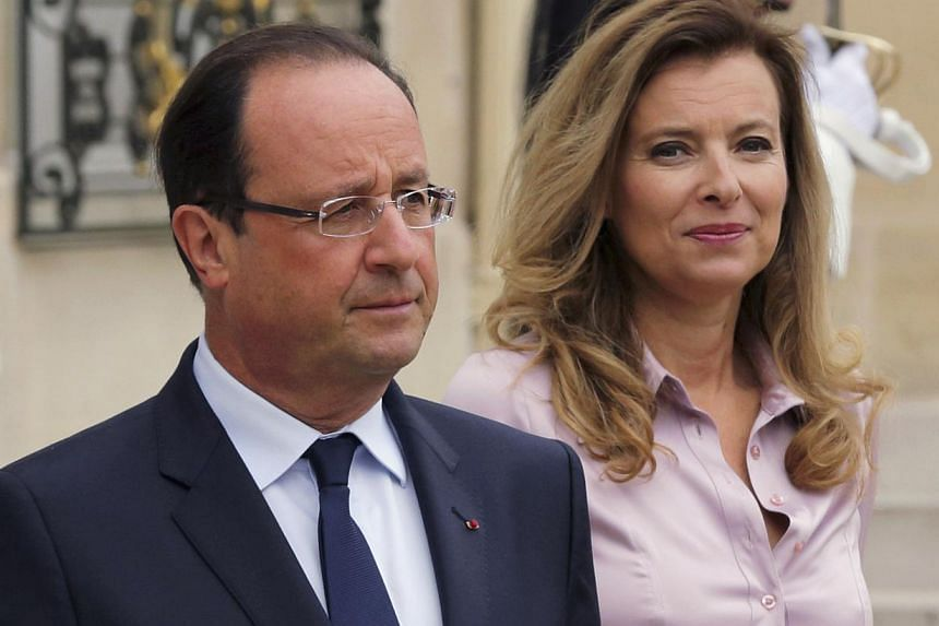 French President Francois Hollande (left) and first lady Valerie Trierweiler accompany guests following a meeting at the Elysee Palace in Paris in this Oct 1, 2013 file photo. French President Francois Hollande's political and personal woes deepened