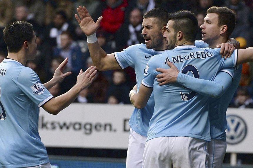 Manchester City's Edin Dzeko (right) celebrates his goal against Newcastle United with Samir Nasri (left), Aleksander Kolarov (second, left) and Alvaro Negredo during their English Premier League soccer match at St James' Park in Newcastle, northern