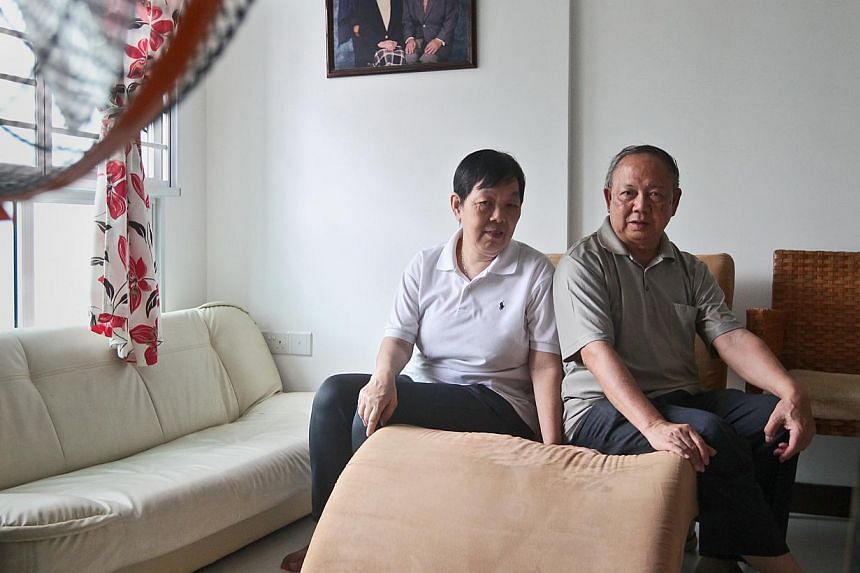 Choy Mui Leng, 66, (left) and her husband Chow Futt Yeow, 77, consider themselves lucky as they qualified for the Silver Housing Bonus when they bought a three-room BTO flat in Punggol. -- ST PHOTO: JASON QUAH
