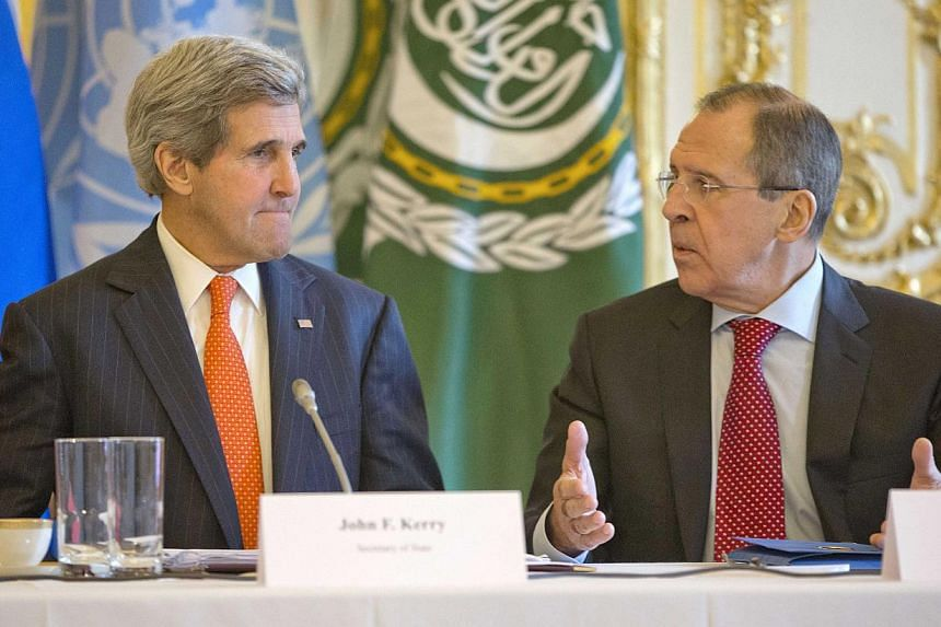 US Secretary of State John Kerry (left) listens to Russia's Foreign Minister Sergei Lavrov before the start of their joint meeting with UN/Arab League envoy for Syria Lakhdar Brahimi (not pictured) at the US ambassador's residence in Paris, on Jan 13