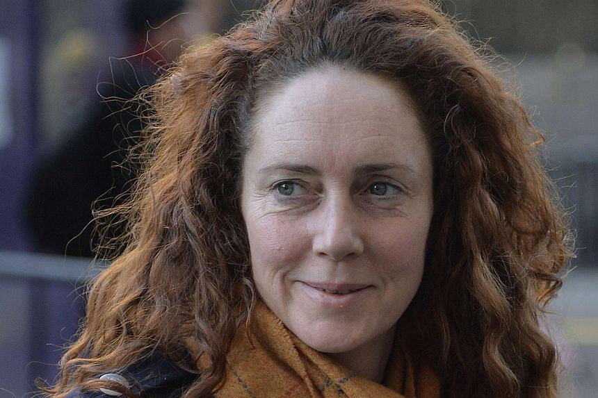 Former News International chief executive Rebekah Brooks arrives at the Old Bailey in central London, on Dec 18, 2013. Rebekah Brooks, the former head of Rupert Murdoch's British newspaper arm, asked for her office to be swept for listening devices t