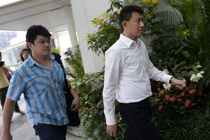 Tan Ye Pengarrives at the Subordinate Courts on Monday, Jan 13, 2014.-- ST PHOTO:DESMOND LIM