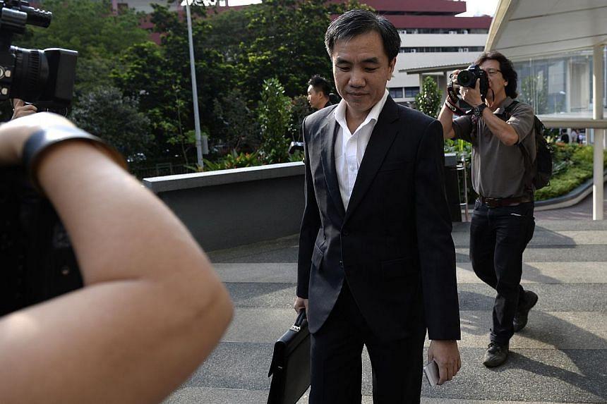 John Lam Leng Hungarrives at the Subordinate Courts on Monday, Jan 13, 2014.-- ST PHOTO:DESMOND LIM