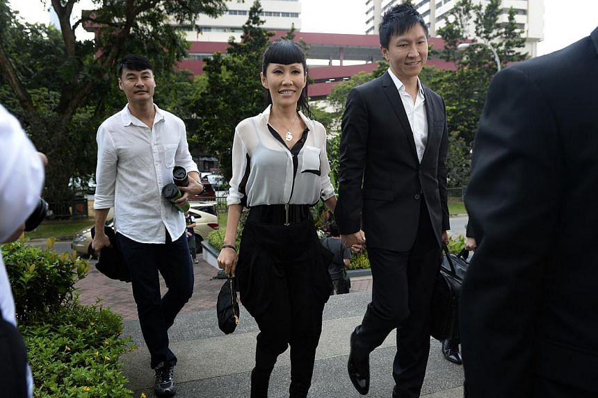 Kong Hee and Ho Yeow Sunarrive at the Subordinate Courts on Monday, Jan 13, 2014.Information about allegedly sham bonds at the centre of the City Harvest Church trial had been kept from the auditor in charge of the firm issuing the bonds,