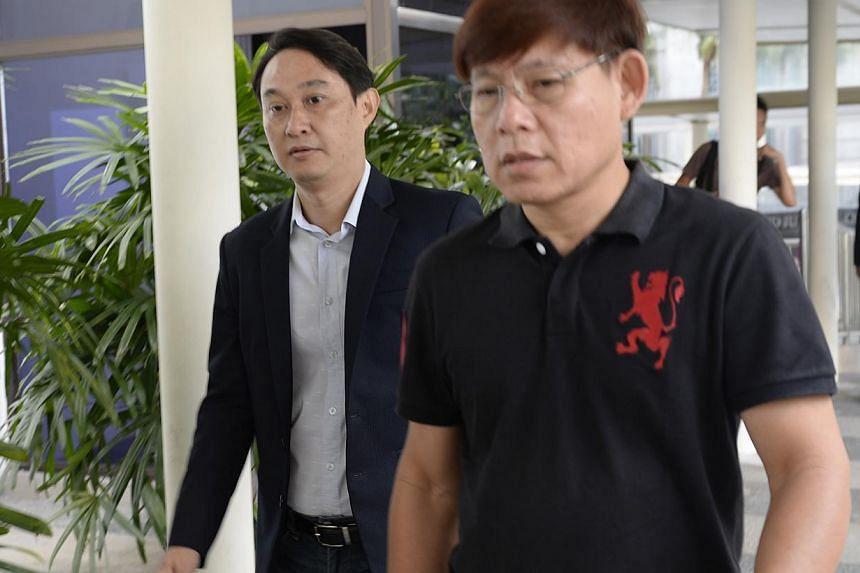 Chew Eng Hanarrives at the Subordinate Courts on Monday, Jan 13, 2014.-- ST PHOTO:DESMOND LIM