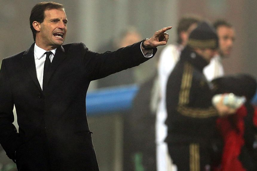 Struggling Italian Serie A football giants AC Milan sacked coach Massimiliano Allegri on Monday, Jan 13, 2014, a day after a 4-3 league defeat by league newcomers Sassuolo.-- PHOTO: AFP