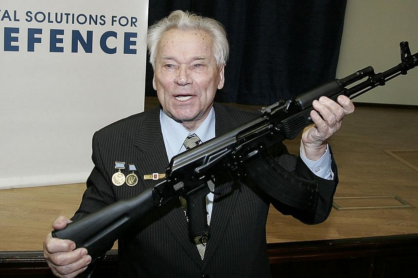 Mikhail Kalashnikov, Russian inventor of the fabled AK-47 assault rifle, holding an AK-103 while he poses for a picture after a press conference in Moscow, onApril 15, 2006. Kalashnikov turned to the head of the Russian Orthodox Church shortly