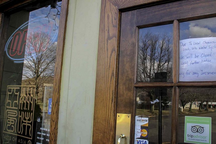 A sign on the door notifies customers that a restaurant is closed due to the water emergency in South Charleston, West Virginia on Jan 11, 2014. Restaurants and shops were reopening on Sunday in parts of West Virginia where the water supply was poiso