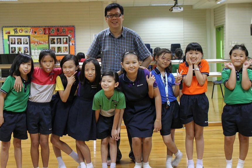 Songwriting enthusiast Richard Wan, 52, with the nine Meridian Primary School pupils who sang the songs, titled It Is Fun & Do It Now and Our Garden, in English and Mandarin to promote bilingualism. The music videos can be seen via the We Love Bi